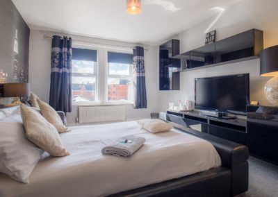 widescreen-tv-in-bedroom-at-tlc-bed-and-breakfast-exmouth